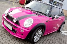 Pink mini with a zebra print roof.