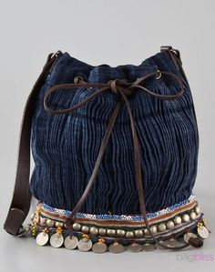Denim bohemian bag with beads, coins & ribbons adorning the bottom.