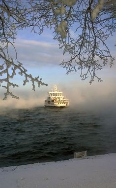 Ferry coming to Suomenlinna sea fortress in January 2016. The sea is icing, amazingly beautiful...