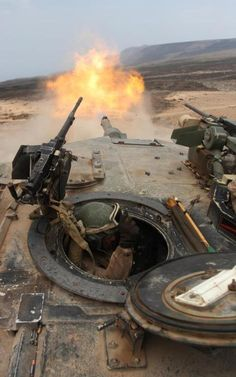 A Marine braces himself while firing a 120 mm round from an M1A1 Abrams tank during a live-fire exercise alongside the French military in Djibouti, Africa.