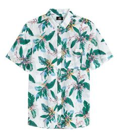 Short-sleeved shirt in soft cotton voile with a narrow button-down collar and one chest pocket. Regular fit.