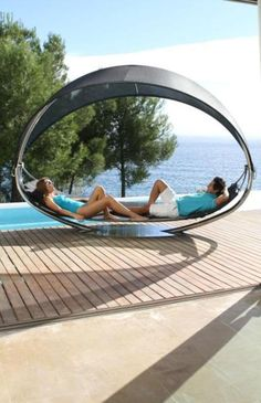 Cool outdoor hammock bed. Two person hammock with splendid design. This outdoor bed is suitable to take place at outdoor pool side. Seating or lie down on this hammock while is enjoying dramatic scenery of nature is so wonderful. It is serving as comfortable seat and bed at same time. Enjoying beautiful views of sky and stars wouldn't be boring at this hammock. In two person hammock, you would be accompanied by closed friend to talk while is seeing stars at night.