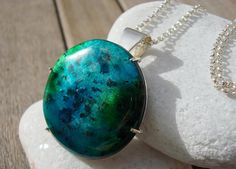 Silver necklace with a green and blue enamel pendant by kimsujo