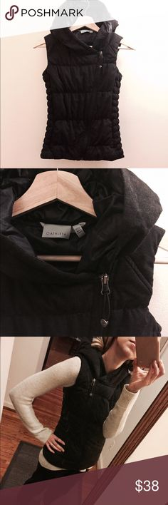 """Athleta fitted charcoal hooded puffer vest Perfect for long walks or running chilly errands in style, this vest is warm, sleek, and versatile. Wear it closed to show the cool side zip or let it drape open. Deep gray color, almost black, slightly heathered for a great fabric texture. Down filling; nylon lining; poly/rayon shell. Machine washable. Generous attached hood. Approx. 23"""" long. Reposh, but in excellent condition. Athleta Jackets & Coats Vests"""