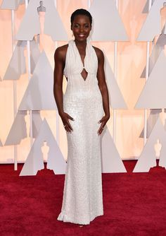 Lupita Nyong'o - 2015 Academy Awards Red Carpet...Beautiful & unique. Pick 1-3 details & embellishments that fit your style to recreate your special look. Cheaper to have custom-made than purchasing from salon. Work with a seamstress to achieve that special look.
