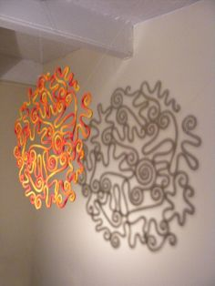 Sun and shadow ~ Amazing sculptural designs achieved with crochet and plastic coated wire. {La Belle Helene: Sunburst}