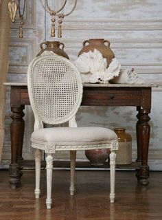 White-washed and antiqued cane back chair with dark table. Love the contrasts.