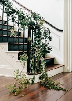 A luxurious indoor wedding with staircase vines.