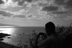 Capturing a photo high above Waimea Bay Beach