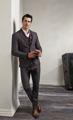 Shop this look on Lookastic: https://lookastic.com/men/looks/blazer-cardigan-dress-shirt-dress-pants-derby-shoes-scarf/6751 — Brown Leather Derby Shoes — Charcoal Dress Pants — Charcoal Gingham Scarf — Charcoal Blazer — Black Cardigan — White Dress Shirt