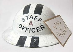 This is a WW2 British Ambulance Service Staff Officer stencil. It allows you to hand paint the text 'STAFF A OFFICER' on the front of the Tommy Helmet. This particular helmet example also had the 'A' stencilled on the rear of the helmet.   http://www.warhats.com/store/p497/WW2_British_Ambulance_Staff_Officer_Stencil.html   www.warhats.com