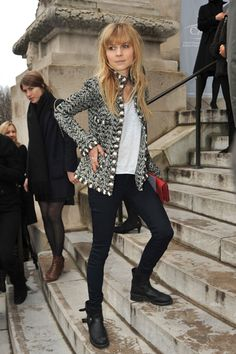 The always-gorgeous Clemence Poesy also took the tough route, opting for skinny black pants and comfortable motorcycle boots that she paired with a basic white tee and classic black and white Chanel tweed jacket. Her red nails and clutch are a cute and simple way to add in a little color.