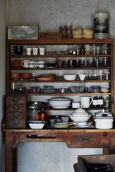 kitchen shelf. everything you need minus the clutter of those low down cubbies full of mismatched tupperware.