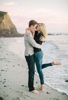 Adorable engagement photo on the beach. I like the pose! Engagement photography | beach engagement photos | couple photos