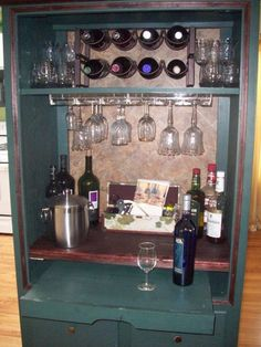 Idea: Armoire becomes Bar, TV armoire converted into a bar, I added a light behind the shelf (the under the counter kind for cabinets)  The light adds just enough lumination.  The shelf still pulls out and can be used for more counter space. , Other Spaces Design