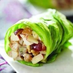 CHICKEN APPLE WRAPS 1/2 cup chopped cooked chicken breast 3 Tbls chopped Fuji apple 2 Tbls chopped black or red grapes 2 Tbls Crunchy Peanut Butter 1 Tbls lite mayo (or greek yogurt) 2 tsp honey Iceberg lettuce Chop chicken meat and fruit, mix in bowl. Mix in peanut butter, mayonnaise  honey. Spoon into open lettuce leaf, roll  serve