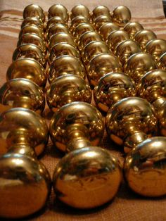 48 Vintage Brass Knobs for Cupboards and Drawers with Original Screws. $39.00, via Etsy.