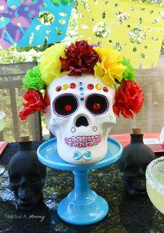 Turn a ceramic skull into a colorful calavera for Día De Los Muertos!