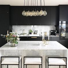 This lighting is perfect for a modern kitchen. This lighting is perfect for a modern kitchen. This lighting is perfect for a modern kitchen. This lighting is perfect for a modern kitchen. Black Kitchen Cabinets, Black Kitchens, Luxury Kitchens, Home Kitchens, White Cabinets, Kitchen Black, French Kitchens, Marble Kitchen Countertops, Calcutta Marble Kitchen