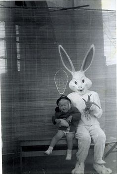 Yup weirder, giant bunny rabbit with squirming child.
