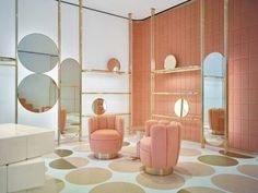 See inside the India Mahdavi designed Red Valentino store in London: The circular mirrors, patterned floor and defined Charlotte armchairs are all reminiscent of a 1960s/1970s era meshed with the glamour of Art Deco.