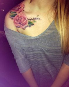 Love this style of rose tattoo.