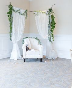An enchanted-garden setting. Add an additional pot with twig branches & sheer panels in the back connecting to the two in front, drape with white string lights.
