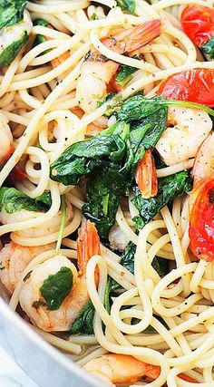 Lemon Shrimp and Spinach Spaghetti - A quick, healthy, one skillet pasta dinner with spaghetti and shrimp tossed in a spinach mixture with tomatoes, garlic, and lemon juice.