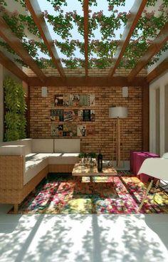 Sala charmosa com pergolado de madeira