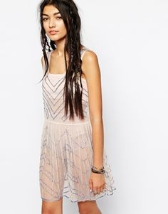 With a nice slip and belt/ribbon  Free People Embellished Slip Dress in Mesh