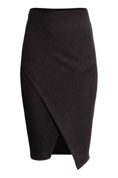 Pencil skirt in thick jersey with a wrap front. Concealed elastication at waist.