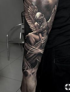 25 Most Amazing Forearm Tattoo Designs for Men 2019 People are always looking for new ways to express themselves and their styles. Forearm tattoos are among the most popular choice of tattoo these days. Angel Sleeve Tattoo, Best Sleeve Tattoos, Angel Tattoo Men, Realistic Tattoo Sleeve, Cross Tattoo Designs, Tattoo Sleeve Designs, Tattoo Designs Men, Cross Designs, Forearm Tattoo Design