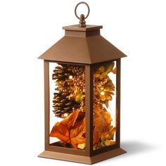 The National Tree Company LED Harvest Arrangement Lantern is a unique and beautiful accent for your Fall season décor. This piece features mini LED string lights that give faux autumn hued foliage inside a glass lantern a warm and welcoming glow. Fall Lanterns, Lanterns Decor, Fall Lantern Centerpieces, Inexpensive Centerpieces, Large Lanterns, Flower Centerpieces, Fall Home Decor, Autumn Home, Autumn Decor Living Room