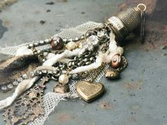 I have some vintage thimbles I've been saving to use in my jewelry making...this is a fabulous idea; so pretty!