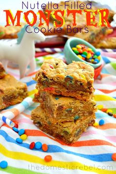 Nutella-Filled Monster Cookie Bars -- these sweet and salty bars are the perfect pick-me-up with a delectable Nutella ribbon swirled throughout!