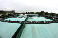 Courts are covered during a rain delay on Day Three. - Chris Raphael/AELTC