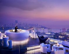 Evening cocktails and midnight small dishes complement the open-air atmosphere of chic relaxation at Aer, Mumbai's highest rooftop bar at the Four Seasons Mumbai. Covering the entire rooftop of the hotel, the bar -- 34 stories above the city --offers panoramic city and sea views and an endless ceiling of sky and stars, creating an atmosphere that redefines the notion of freedom. (Courtesy Four Seasons)