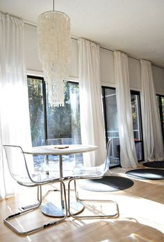 make windows even bigger by hanging the curtains from the ceiling.
