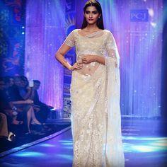 Gorgeous Sonam Kapoor dressed in Neeta Lulla's beautiful beige net saree embellished with bead and gota embroidery at IIJW 2014.  Avail now at:  http://store.neetalulla.com/saree/nsl-cl-1090 #neetalulla #czarinaofindianfashion