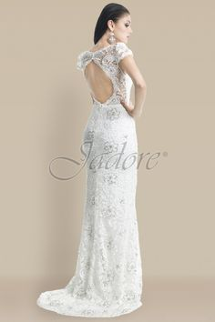 Beautiful key hole back gown. Available at The Ultimate Bride.