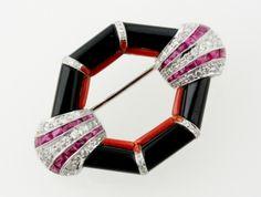 An Art Deco style diamond, ruby, coral and black onyx brooch - Fine Jewellery - 27 January  - 1 February 2012 - Auction Atrium