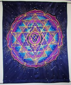 I created the Universal Wisdom silk wall hanging based on the Sri Yantra mandala. The Sri Yantra is known as the Cosmic Yantra or Yantra of Creation is the most revered of all the Hindu Yantras. By meditating on the Sri Yantra, an attunement of individual consciousness with the harmony of universal consciousness develops. The Sri Yantra is the symbol of nine intersecting triangles within a circle or lotus, and is an interpretation of divine feminine energy intersecting divine masculine…