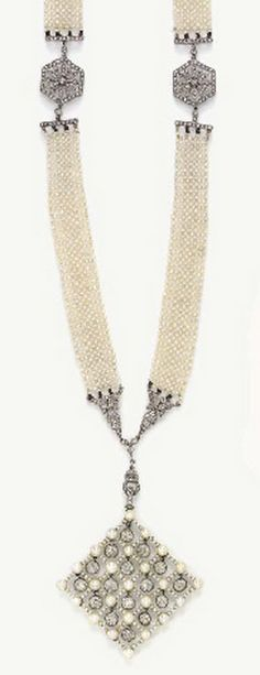 A BELLE EPOQUE SEED PEARL AND DIAMOND SAUTOIR  Suspending a kite-shaped seed pearl and diamond plaque of checkerboard design, suspending a series of bezel-set old European-cut diamonds, to the diamond floral links and seed pearl mesh chain, spaced by openwork rose and single-cut diamond foliate links, mounted in platinum, circa 1905, 23¼ ins.