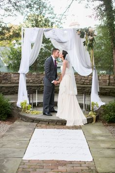 sheer draped fabric makes a lovely wedding arch ~  we ❤ this! moncheribridals.com