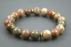 Autumn jasper and Morocco agate stacking stretch bracelet with brass spacers from the Earthwear Collection