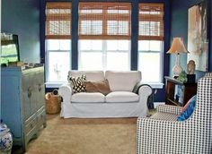 4-season room turned into a cozy den.