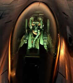 An Fighting Falcon Pilot Peers by Stocktrek Images Military Jets, Military Aircraft, Fighter Pilot, Fighter Jets, F 16 Falcon, Aircraft Pictures, War Machine, Armed Forces, Us Air Force