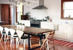 Dining table as kitchen island - great idea. Love the light fixture too.