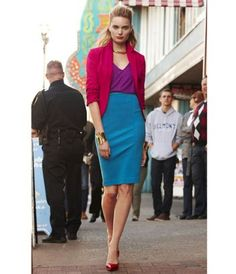"Blue skirt...wear it with an ivory tie neck blouse and nude heels for a less ""in your face"" effect"