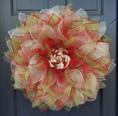 Deco Mesh Poof Wreath Tutorial This is a tutorial for a deco mesh flower wreath. I am using Christmas colors since it's the holiday season, but you can use any colors you like! You'll end up with a beautiful wreath to compliment any home decor! Christmas Flowers, Christmas Ribbon, Christmas Colors, Christmas Crafts, Christmas Holiday, Crochet Christmas, Holiday Ideas, Christmas Ideas, Mesh Garland